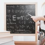 E-mc2 written on chalkboard